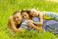 Beautiful young family having fun outdoors Stock Image