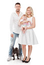 Beautiful young family with little baby and dog isolated over white background Royalty Free Stock Photos