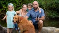 Beautiful young family with their pet dog, golden retriever Royalty Free Stock Photo