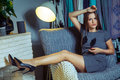 Beautiful young fashion caucasian model posing near armchair. Royalty Free Stock Photo