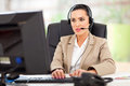 Beautiful young female call center operator headset office Royalty Free Stock Photography