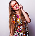 Beautiful young female face with bright fashion multicolored make up photo Royalty Free Stock Photography