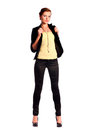 Beautiful young female fashion model dressed in black fitting trousers black jacket and yellow top on high heels standing Stock Images