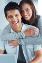 Beautiful young female hugging her boyfriend Stock Images