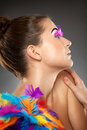 Beautiful young female model with bold make up and feathers Stock Image