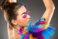 Beautiful young female model with bold make up and feathers Royalty Free Stock Images
