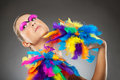 Beautiful young female model with bold make up and feathers Royalty Free Stock Photography