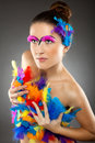 Beautiful young female model with bold make up and feathers Stock Photos