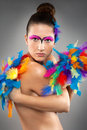Beautiful young female model with bold make up and feathers Stock Photo