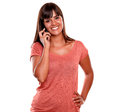 Beautiful young female speaking on cellphone Royalty Free Stock Photography