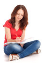 Beautiful young female student sitting studying Royalty Free Stock Photography