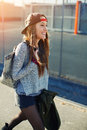 Beautiful young female walk on a street relaxing and enjoying sunny evening outdoors cropped shot of stylish teenager walking in Stock Image