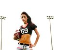 Beautiful young football woman Stock Photos