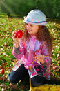 Beautiful young girl in autumn garden holding apples Stock Photography