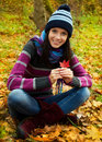 Beautiful young girl in autumn park Royalty Free Stock Images