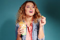 Beautiful young girl with blond hair and evening makeup eating popcorn Royalty Free Stock Photo