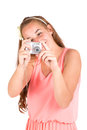 Beautiful young girl with camera in pink dress Stock Image