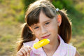 Beautiful young girl enjoying ice cream Royalty Free Stock Photography