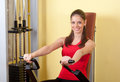 Beautiful young girl exercising in the gym Royalty Free Stock Photo