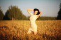 Beautiful young girl in field a Royalty Free Stock Images