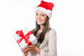 Beautiful young girl with gift in hand on a white background santa hat Stock Images
