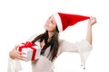 Beautiful young girl with gift in hand on a white background santa hat Stock Photography