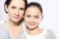 Beautiful young girl with her mother mom daughter isolated on white background Stock Photography