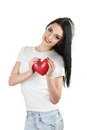 Beautiful young girl holding red heart Stock Photo