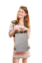 Beautiful young girl holding a shopping bag Royalty Free Stock Photo
