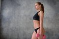 Beautiful young girl with an ideal figure and dumbbells Royalty Free Stock Photo