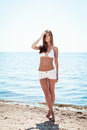 Beautiful young girl in a knitted swimsuit and shorts Stock Image