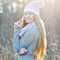 Beautiful young girl with long hair in a hat on a sunny day Royalty Free Stock Photo