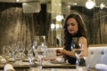 Beautiful young girl in luxury restaurant interior Royalty Free Stock Photo