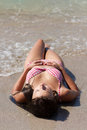 Beautiful young girl lying on the beach Stock Images