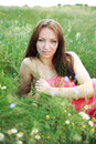 Beautiful young girl lying in the green field summer Stock Images