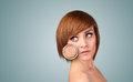 Beautiful young girl with magnifying glass of skin damage healthy Stock Images