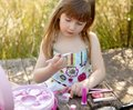 Beautiful young girl with make up set outdoors Stock Image