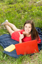 Beautiful young girl with a notebook shows thumb up smiling Royalty Free Stock Images