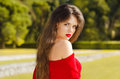 Beautiful young girl Outdoor portrait. Attractive Woman with red Royalty Free Stock Photo