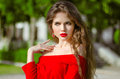 Beautiful young girl Outdoor portrait. Fashion brunette in red d Royalty Free Stock Photo