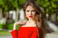 Beautiful young girl Outdoor portrait. Fashion brunette in red Royalty Free Stock Photo