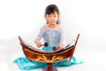 Beautiful young girl playing thai xylophone ranard on white background Stock Photography