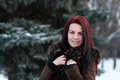 Beautiful young girl portrait on winter background. Charming young lady walking in a winter forest. Attractive woman posing. Royalty Free Stock Photo