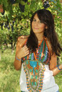 Beautiful young girl posing in a vineyard Royalty Free Stock Photo