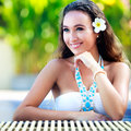 Beautiful young girl relaxing on the swimming pool Royalty Free Stock Photos