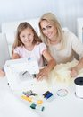 Beautiful Young Girl Sewing With Her Mother Royalty Free Stock Photography