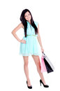 Beautiful young girl with shopping bags in studio standing holding shpping and smiling Royalty Free Stock Images