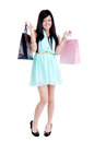 Beautiful young girl with shopping bags in studio standing holding shpping and smiling Stock Photos