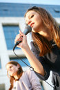 Beautiful young girl singing Stock Photography