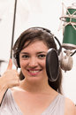 Beautiful young girl singing in music studio Royalty Free Stock Photo